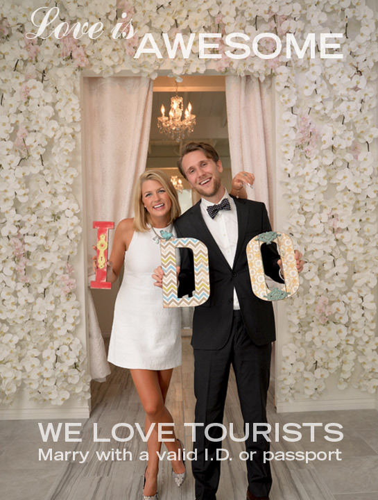 "Albertson Wedding Chapel couple holding ""I Do"" sign"