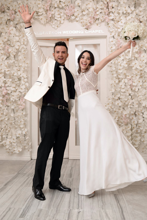 Young couple jumping for joy at Albertson Wedding Chapel